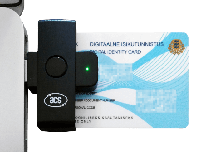 An e-resident card is inserted into a USB reader, allowing for authentication and digitally signing documents.