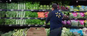 Walmart worker stocking produce (via IBM Blockchain Platform video)