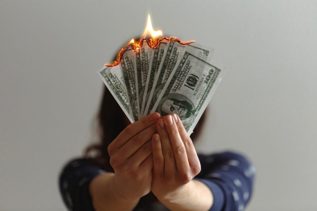 Fake money on fire