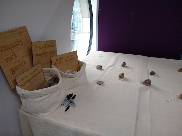 Rocks of various shapes and sizes on a white tablecloth