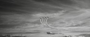 four jet airplanes in formation
