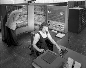 An IBM 704 - circa 1957 - 1514px-IBM_Electronic_Data_Processing_Machine_-_GPN-2000-001881 by NASA via Wikipedia