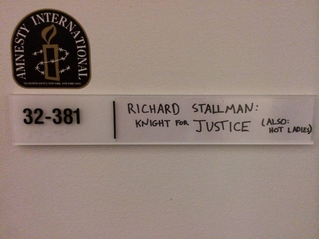 """The door of Richard Stallman's MIT Office with a handwritten whiteboard sign that reads """"Richard Stallman: Knight for Justice (Also Hot Ladies)"""