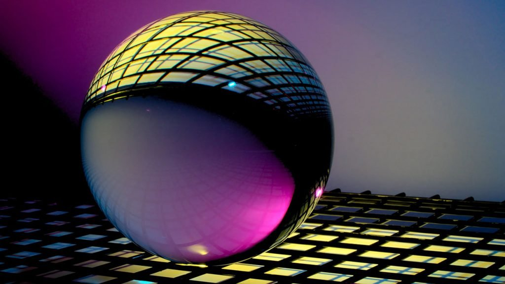 crystal ball on top of lighted grid