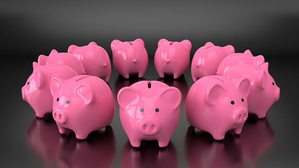 pink piggy banks in a circle